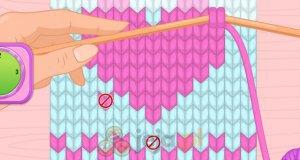 Ellie robi szalik na drutach