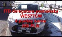 Inspektor Transportu Drogowego w samochodzie z pewną kobietą
